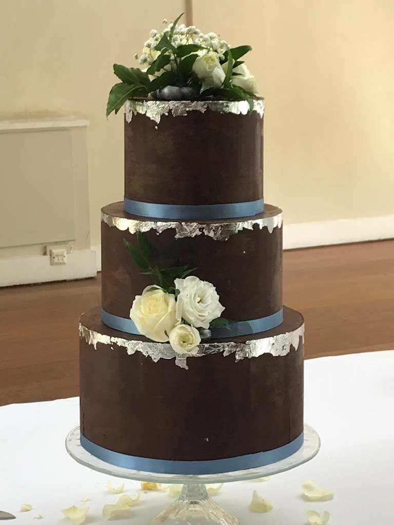 Dolce Lusso Cakes 3 tier chocolate ganache silver leaf fresh flowers blueberries