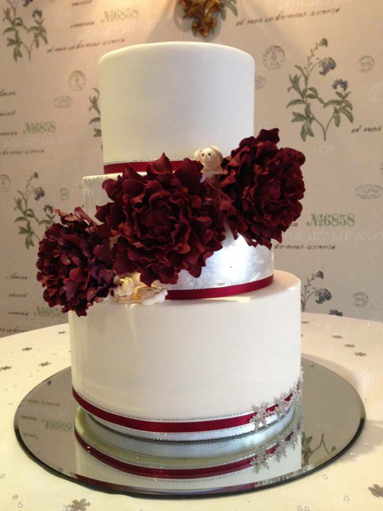 Dolce Lusso Cakes 3 tier winter wedding sugar burgundy peonies silver leaf cake henley