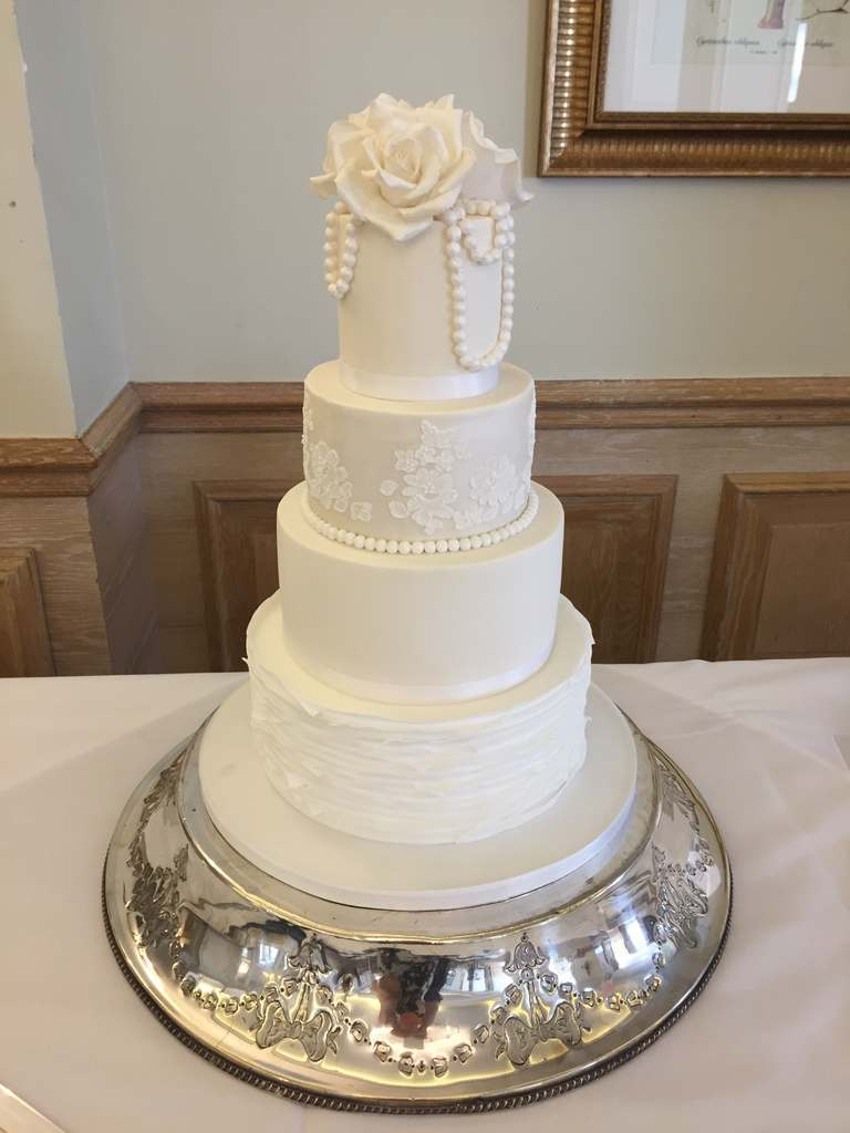 Dolce Lusso Cakes 4 tier white wedding cake lace ruffles pearls roses sugarcraft bespoke shimmer compleat angler