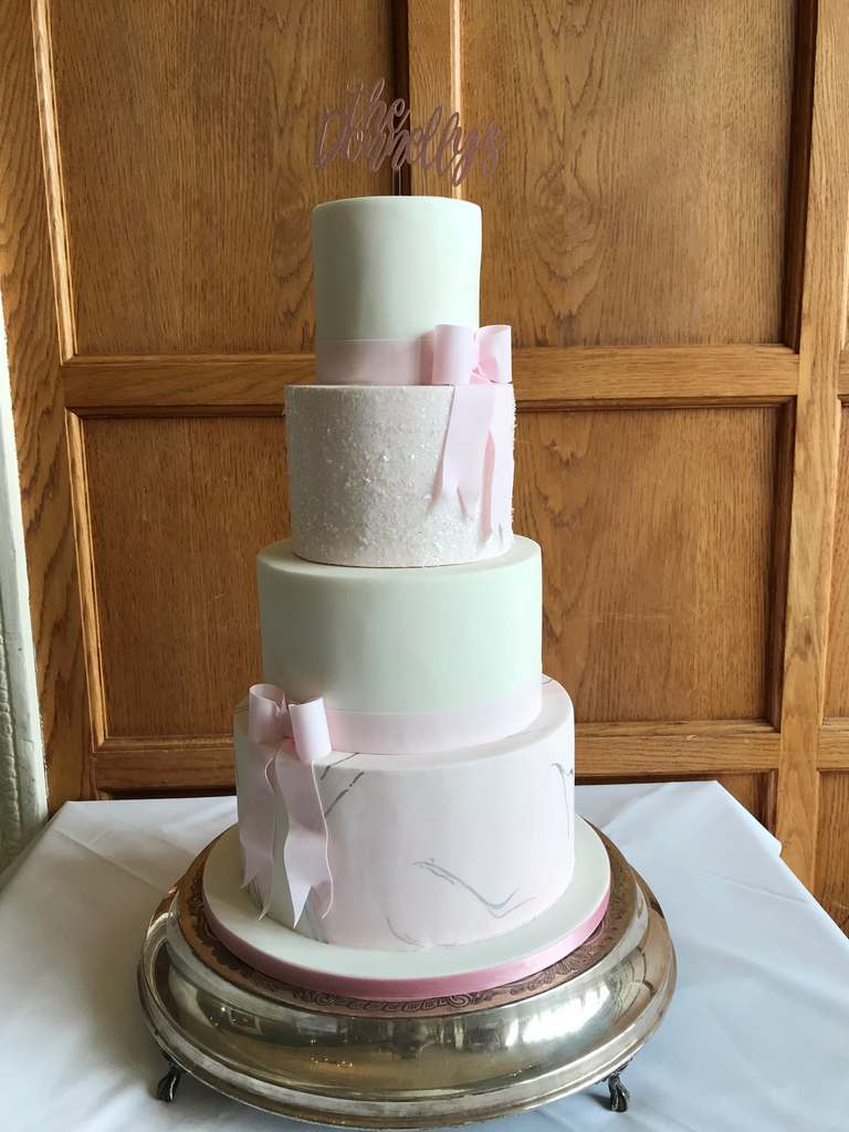 Dolce Lusso Cakes 4 tier pink wedding cake marble silver bows glitter