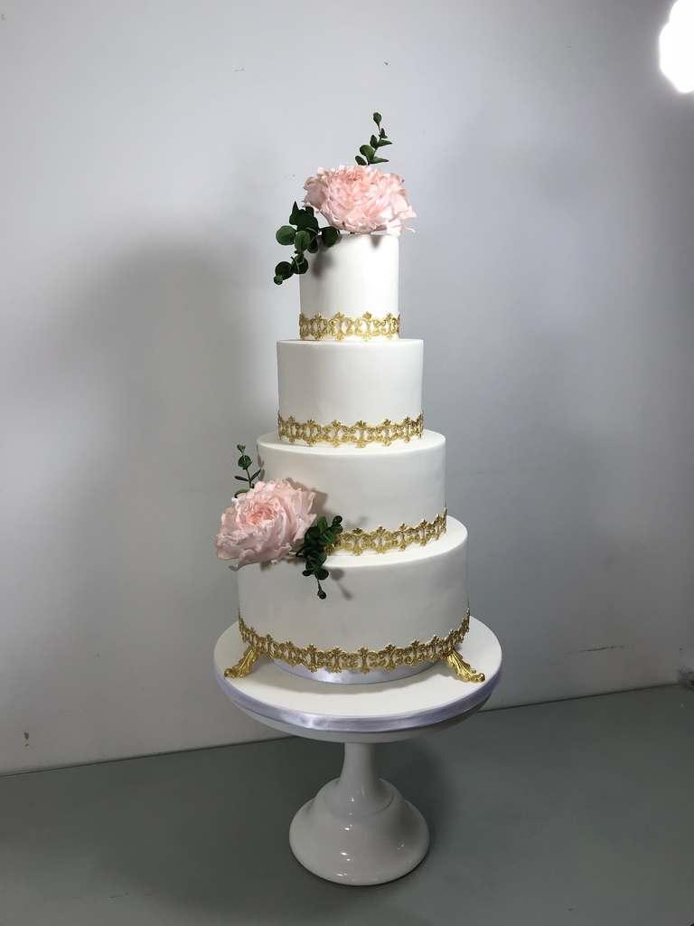 Dolce Lusso Cakes 4 tier wedding cake elegant gold detail lace sugar pink peonies eucalyptus wedding cake