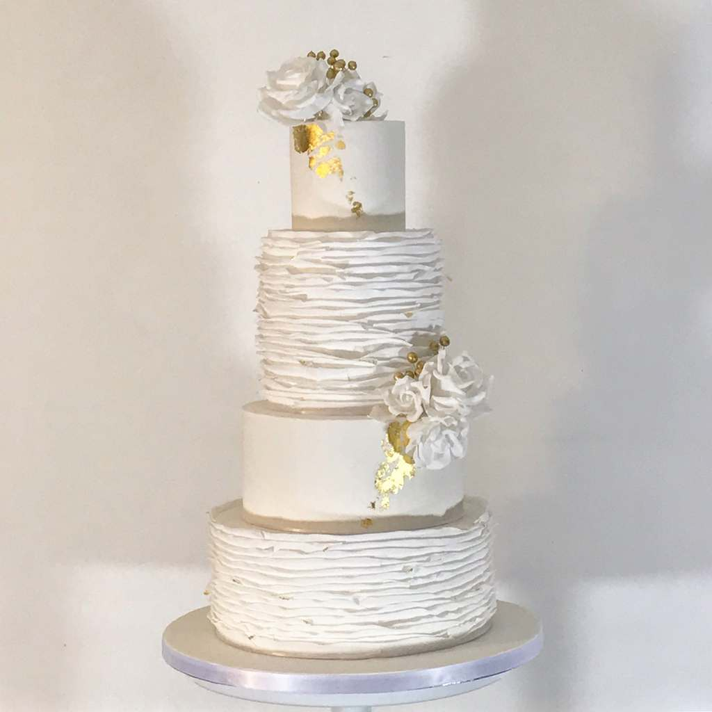 Dolce Lusso Cakes 4 tier wedding cake white ruffles gold leaf sugar rose berries