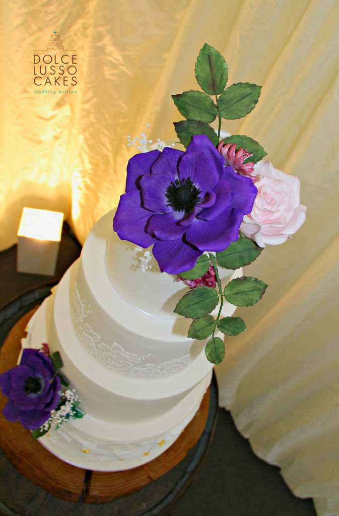 Dolce Lusso Cakes 4 tier weding cake ruffles hand piped lace anenome purple rose sugar flowers