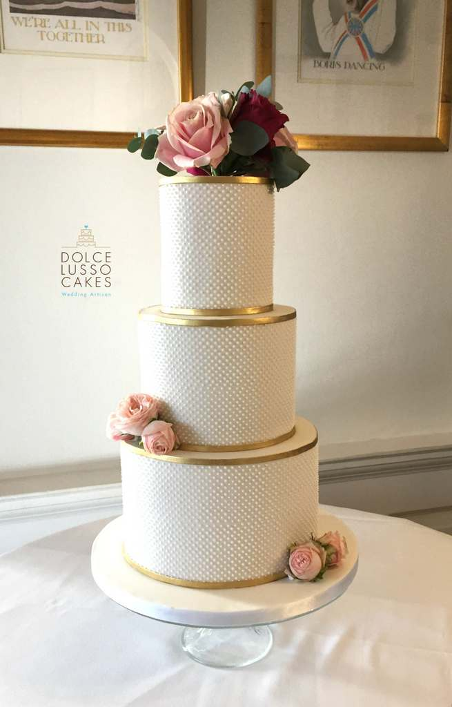 Dolce Lusso Cakes 3 tier wedding cake dots piped gold bands fresh flowers