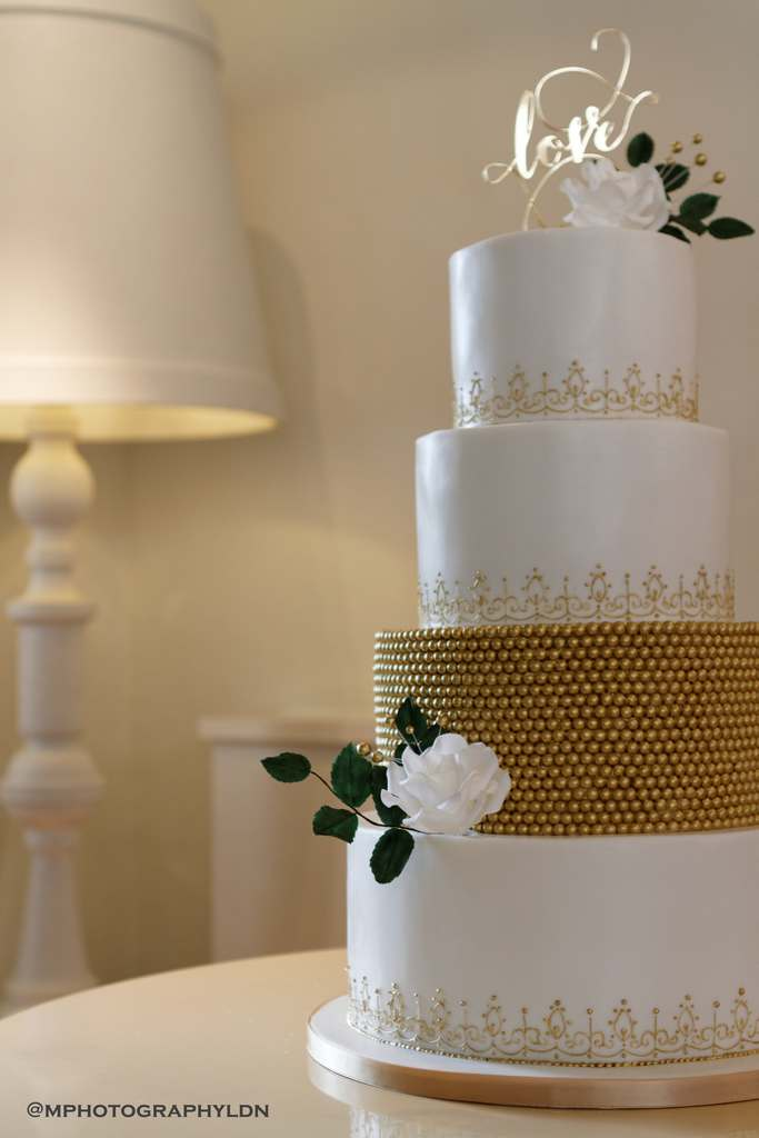 Dolce Lusso Cakes 4 tiered wedding cake white gold pearls bespoke lace design love topper gold buds